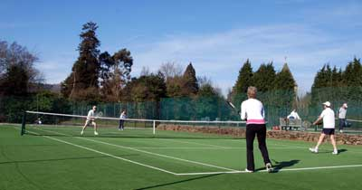 Playing tennis at The Limpsfield Club