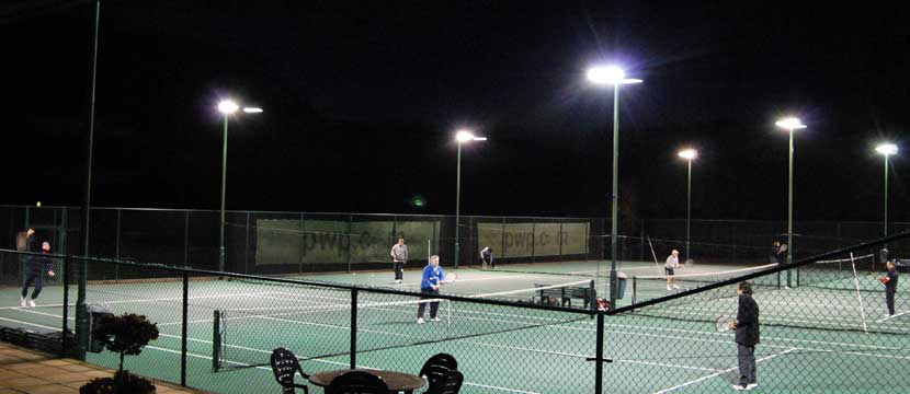 Playing tennis by floodlights at The Limpsfield Club